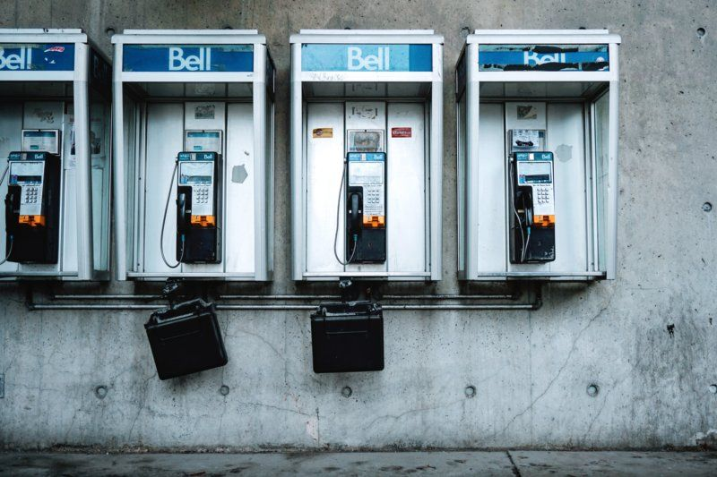 image of a row of pay phones